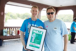 IOCDF executive director Dr. Jeff Szymanski presents the Top Walk Team award to Team Bradley Hospital